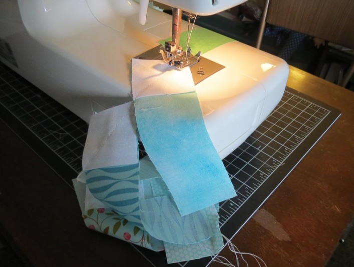 Sewing squares to strips.
